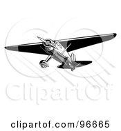 Black And White Airplane Speeding Through The Sky