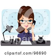 Brunette Receptionist Wearing Glasses Talking On A Phone At Her Desk