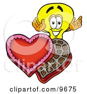 Clipart Picture Of A Light Bulb Mascot Cartoon Character With An Open Box Of Valentines Day Chocolate Candies