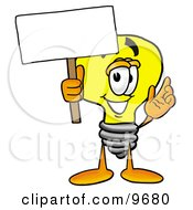 Clipart Picture Of A Light Bulb Mascot Cartoon Character Holding A Blank Sign