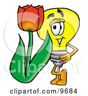 Light Bulb Mascot Cartoon Character With A Red Tulip Flower In The Spring