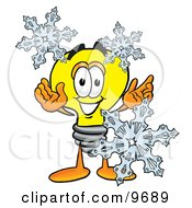 Clipart Picture Of A Light Bulb Mascot Cartoon Character With Three Snowflakes In Winter