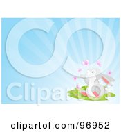Royalty Free RF Clipart Illustration Of A Gray Easter Bunny Sitting In Grass And Watching Butterflies Over A Shining Blue Background