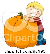Happy Blond Boy Leaning Against A Giant Pumpkin