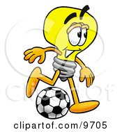 Clipart Picture Of A Light Bulb Mascot Cartoon Character Kicking A Soccer Ball