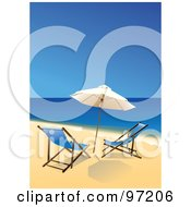 Pair Of Blue Beach Chairs Under An Umbrella At The Waters Edge On A Beach