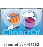 Two Colorful Hot Air Balloons Floating Through A Blue Sky With White Clouds