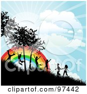Royalty Free RF Clipart Illustration Of Happy Silhouetted Children Running Up A Hillside Near A Rainbow On A Sunny Day