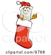 Light Switch Mascot Cartoon Character Wearing A Santa Hat Inside A Red Christmas Stocking