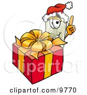 Light Switch Mascot Cartoon Character Standing By A Christmas Present