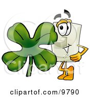 Light Switch Mascot Cartoon Character With A Green Four Leaf Clover On St Paddys Or St Patricks Day