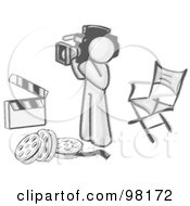 Royalty Free RF Clipart Illustration Of A Sketched Design Mascot Camera Man Filming And Standing By A Directors Chair Rolls Of Film And A Clapperboard In A Studio
