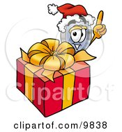Clipart Picture Of A Magnifying Glass Mascot Cartoon Character Standing By A Christmas Present by Toons4Biz