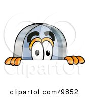 Clipart Picture Of A Magnifying Glass Mascot Cartoon Character Peeking Over A Surface by Toons4Biz