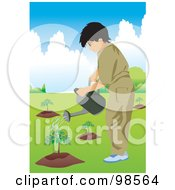 Little Boy Watering Newly Planted Trees
