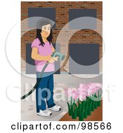 Girl Using A Sprayer To Water Her Flower Garden