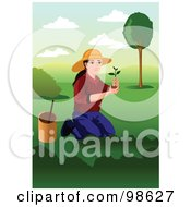 Kneeling Woman Planting A Tree