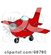 Royalty Free RF Clipart Illustration Of A Red Airplane With A Spinning Propeller by djart