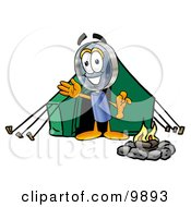 Magnifying Glass Mascot Cartoon Character Camping With A Tent And Fire