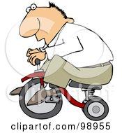 Caucasian Man Riding A Little Trike