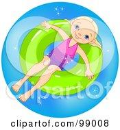 Happy Blond Girl Soaking In An Inner Tube In A Pool