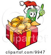 Clipart Picture Of A Rolled Money Mascot Cartoon Character Standing By A Christmas Present