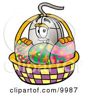 Clipart Picture Of A Computer Mouse Mascot Cartoon Character In An Easter Basket Full Of Decorated Easter Eggs