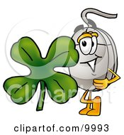 Computer Mouse Mascot Cartoon Character With A Green Four Leaf Clover On St Paddys Or St Patricks Day