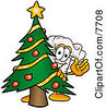 Clipart Picture Of A Chefs Hat Mascot Cartoon Character Waving And Standing By A Decorated Christmas Tree by Toons4Biz