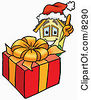 Clipart Picture Of A House Mascot Cartoon Character Standing By A Christmas Present by Toons4Biz