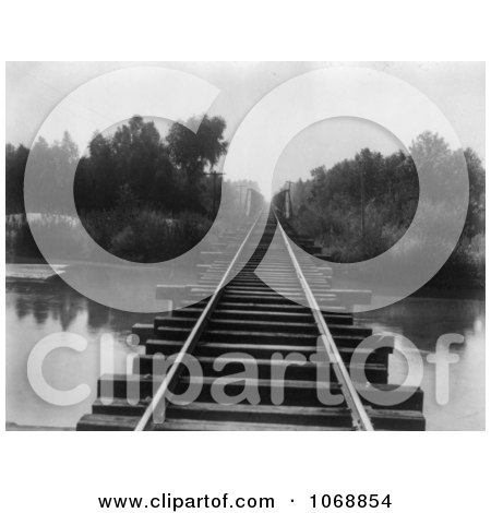 Train Tracks at the Southern Pacific Railroad Bridge Over the Calloway Canal in Kern County, California - Royalty Free Black And White Stock Photography by JVPD
