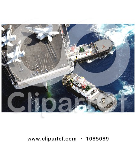 Tugboats Beside An Aircraft Carrier With Military Jets On Board In Guam - Free Stock Photography by JVPD
