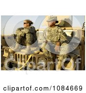 Two Female Army Soldiers On A Vehicle Free Stock Photography