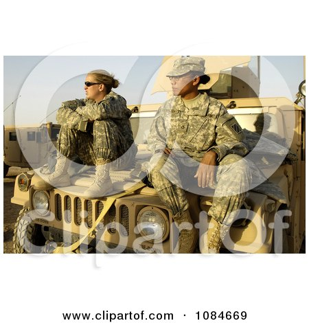 Two Female Army Soldiers on a Vehicle - Free Stock Photography by JVPD