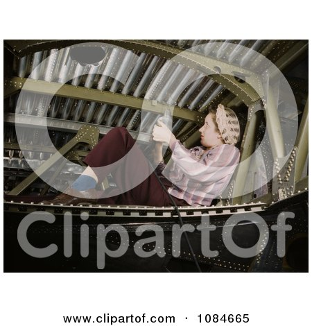 Woman Riveting an A-20 Bomber - Free Stock Photography by JVPD