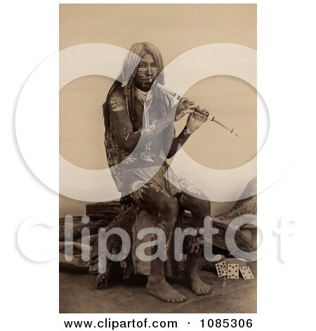 Yuma Indian Playing a Flute - Free Historical Stock Photography by JVPD